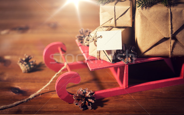 close up of christmas gifts with note on sleigh Stock photo © dolgachov