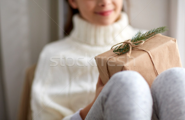 girl with christmas gift sitting on sill at home Stock photo © dolgachov