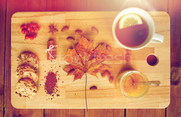 Stock photo: cup of tea with lemon, honey and cookies on board