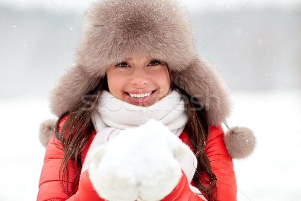 Stockfoto: Gelukkig · vrouw · sneeuw · winter · bont · hoed