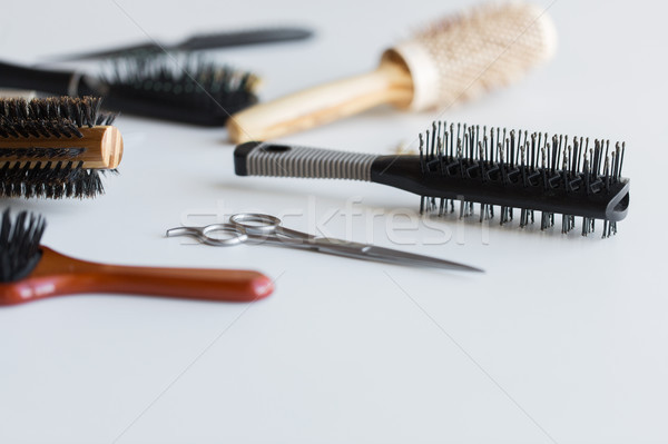 scissors and different hair brushes Stock photo © dolgachov