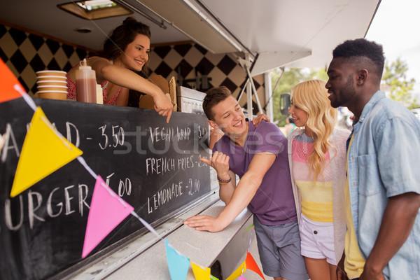 Vendedor menu clientes comida caminhão Foto stock © dolgachov