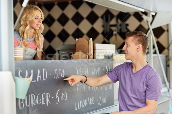 saleswoman at food truck serving male customer Stock photo © dolgachov