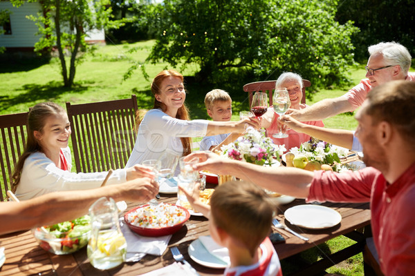 Stock photo: happy family having dinner or summer garden party