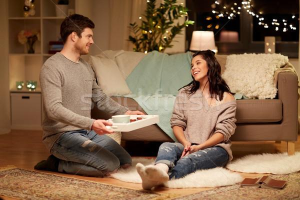 happy couple with food on tray at home Stock photo © dolgachov