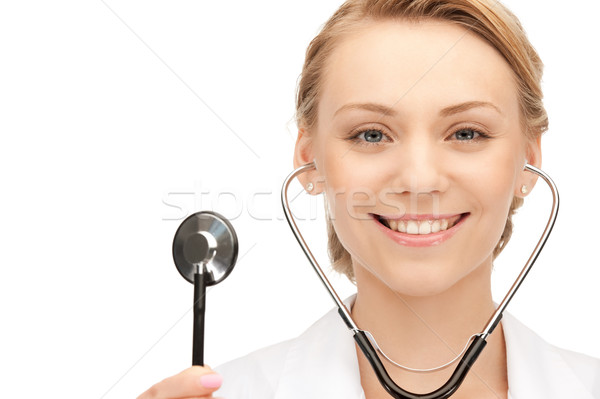 attractive female doctor with stethoscope Stock photo © dolgachov