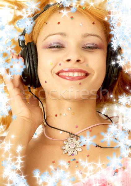 Christmas muziek foto glimlachend luisteren Stockfoto © dolgachov