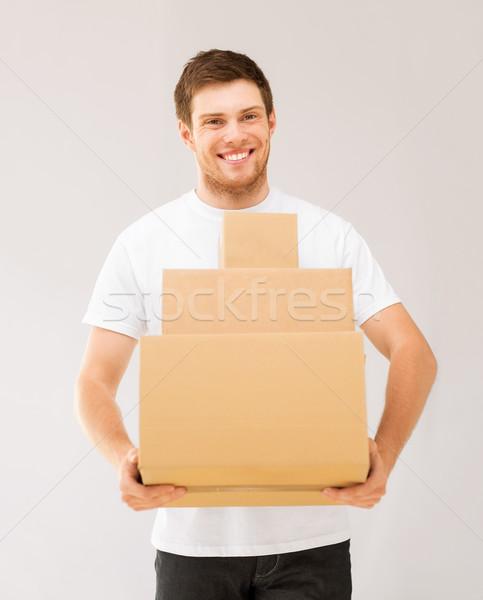 笑みを浮かべて 男 カートン ボックス 画像 ストックフォト © dolgachov