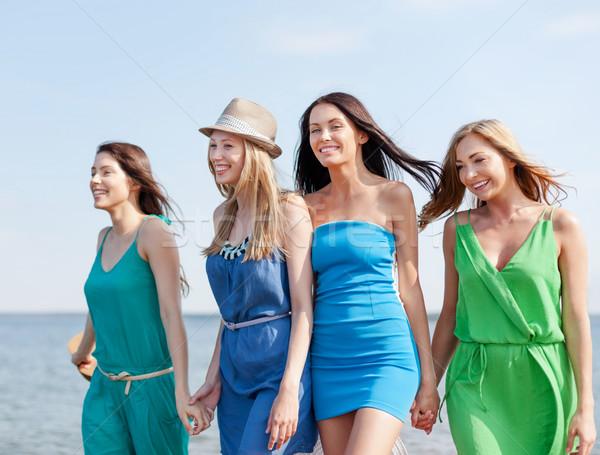 girls walking on the beach Stock photo © dolgachov