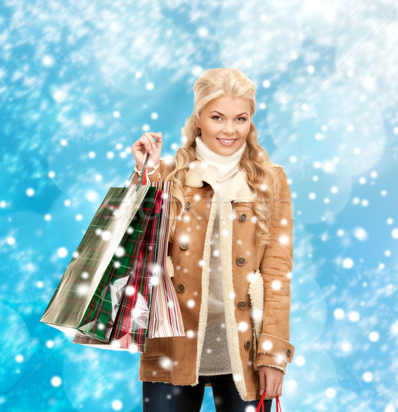 woman in winter clothes with shopping bags Stock photo © dolgachov