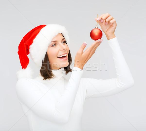 Nő mikulás segítő kalap karácsony labda Stock fotó © dolgachov