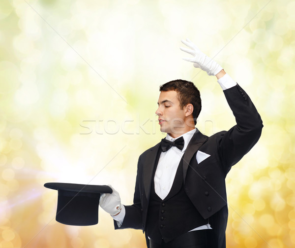 magician in top hat showing trick Stock photo © dolgachov