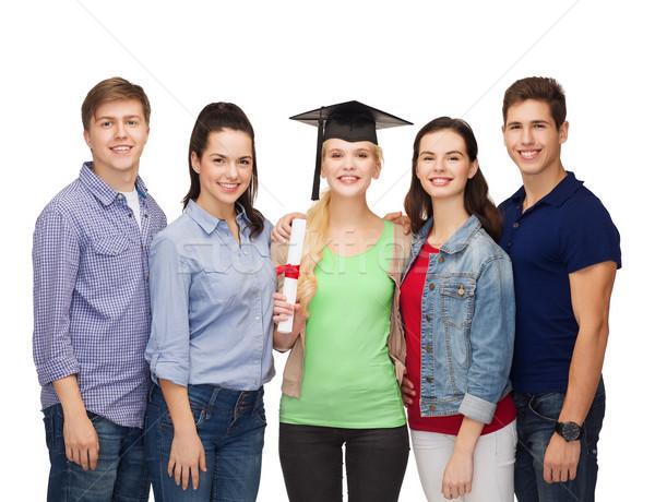 Gruppo piedi sorridere studenti diploma istruzione Foto d'archivio © dolgachov