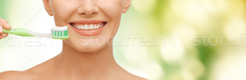 beautiful woman with toothbrush Stock photo © dolgachov