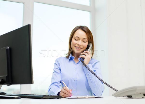 Stockfoto: Zakenvrouw · laptop · bestanden · telefoon · business · communicatie