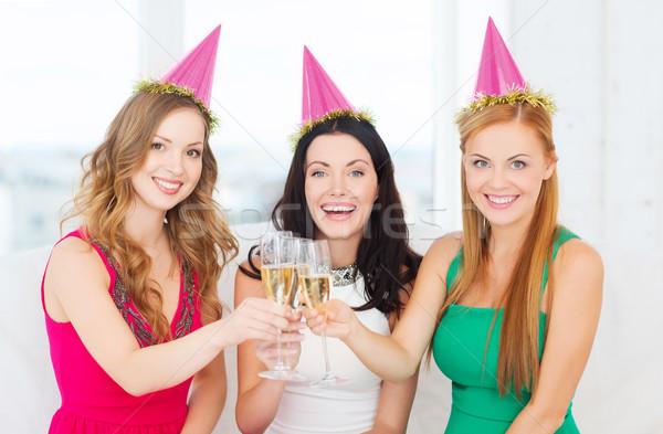 üç kadın şampanya gözlük Stok fotoğraf © dolgachov