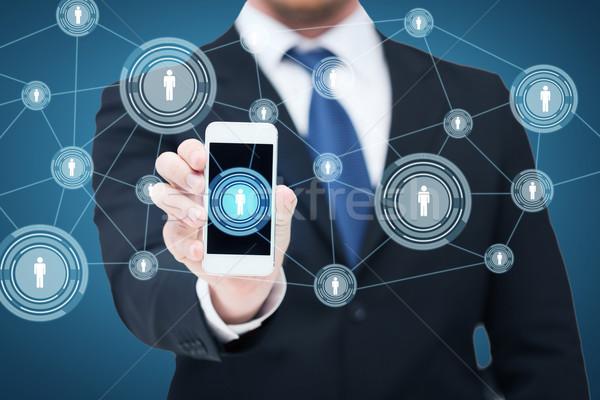 Biznesmen smartphone sieci działalności Internetu Zdjęcia stock © dolgachov