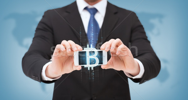 Empresario bitcoin Screen negocios Internet Foto stock © dolgachov