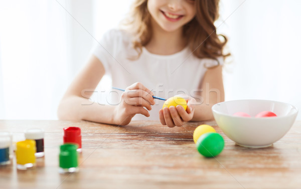 close up of girl coloring eggs for easter Stock photo © dolgachov