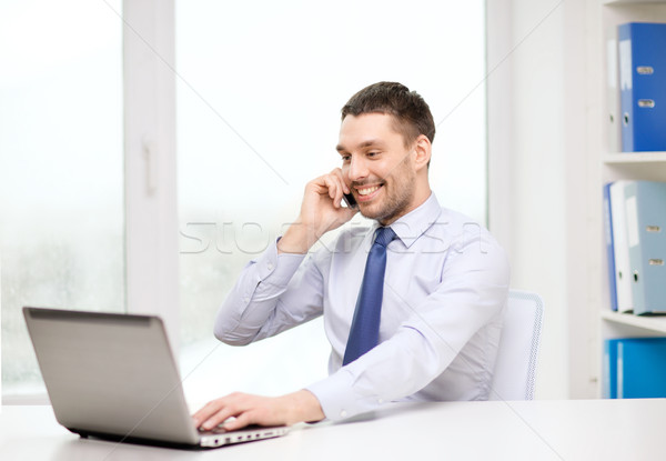 businessman with laptop and smartphone at office Stock photo © dolgachov
