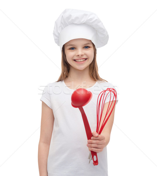 Souriant fille Cook chapeau louche fouet Photo stock © dolgachov
