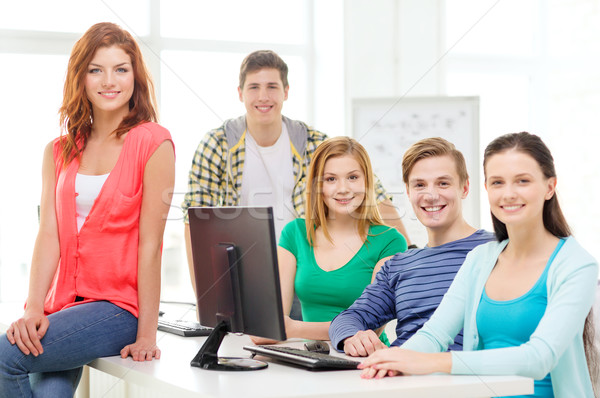 group of smiling students having discussion Stock photo © dolgachov