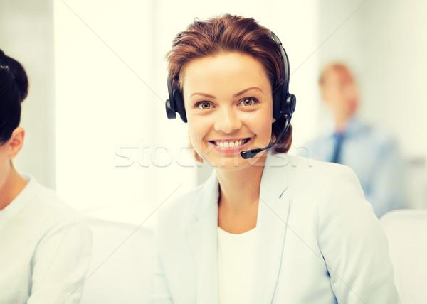 friendly female helpline operator Stock photo © dolgachov