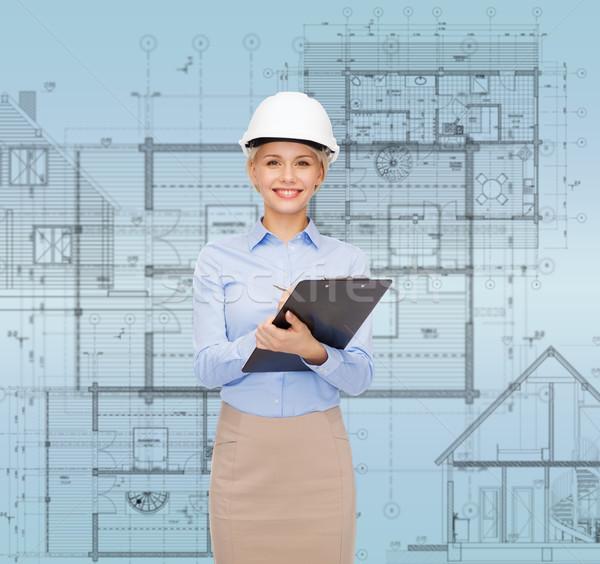 улыбаясь деловая женщина шлема буфер обмена здании развивающийся Сток-фото © dolgachov