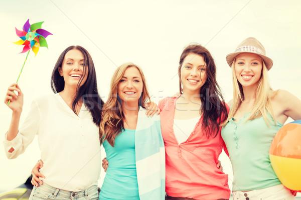 smiling girls having fun on the beach Stock photo © dolgachov