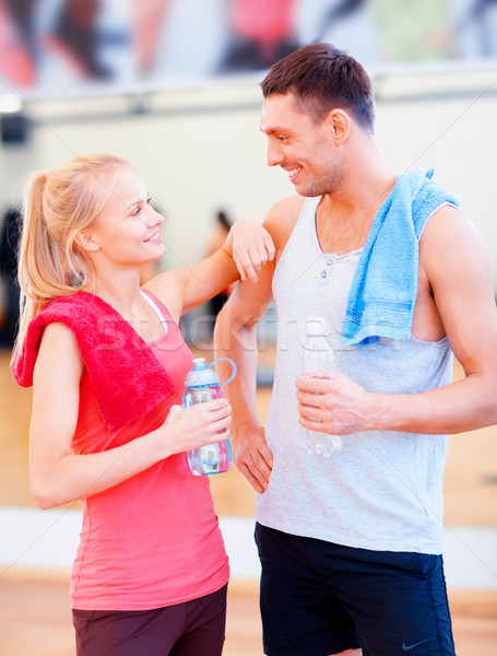 two smiling people in the gym Stock photo © dolgachov