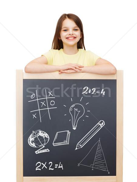 smiling girl with blackboard Stock photo © dolgachov
