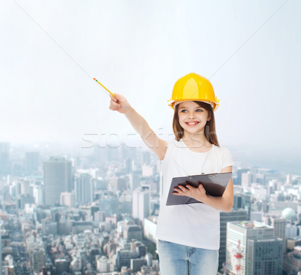 smiling little girl in hardhat with clipboard Stock photo © dolgachov