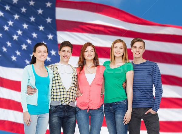 Foto stock: Grupo · sonriendo · estudiantes · pie · educación · personas
