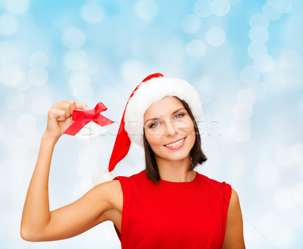 smiling woman in santa hat with jingle bells Stock photo © dolgachov