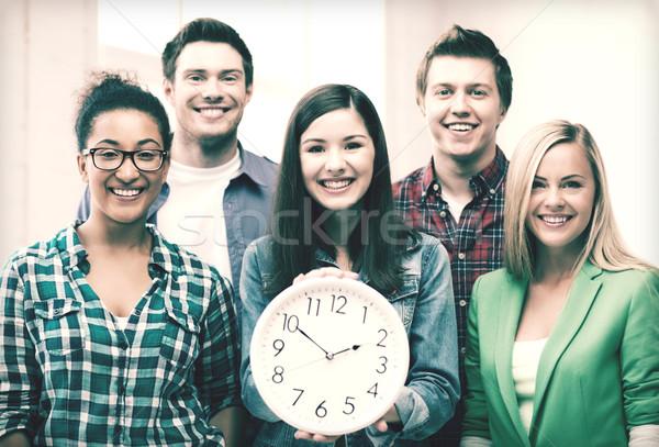 Grup Öğrenciler okul saat eğitim kadın Stok fotoğraf © dolgachov