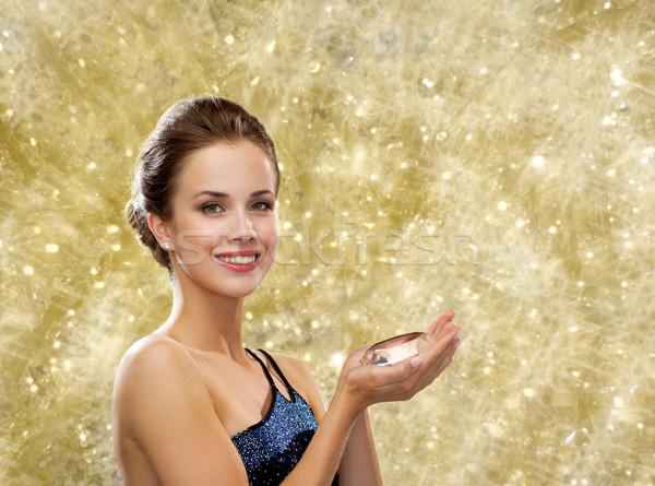 smiling woman in evening dress with diamond Stock photo © dolgachov