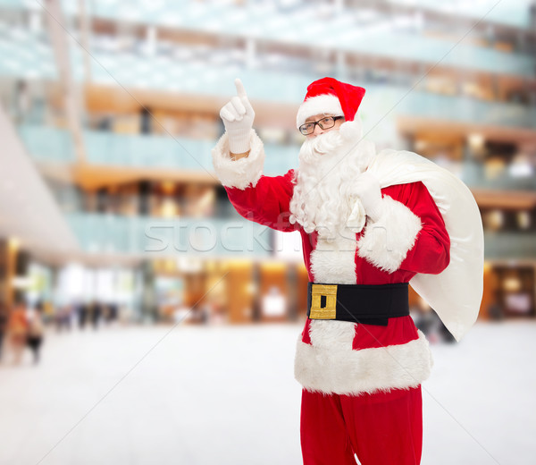 man in costume of santa claus with bag Stock photo © dolgachov