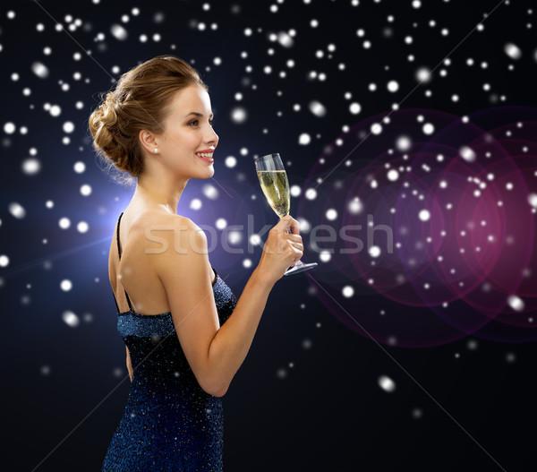 Femme souriante verre vin fête Photo stock © dolgachov