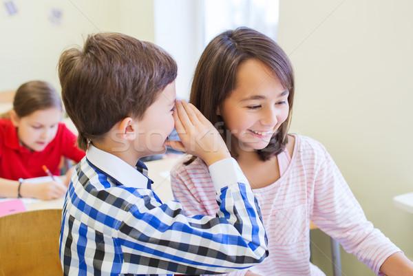 Souriant écolier chuchotement compagne oreille éducation Photo stock © dolgachov