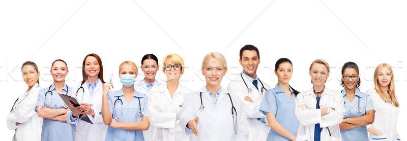 smiling female doctors and nurses with stethoscope Stock photo © dolgachov