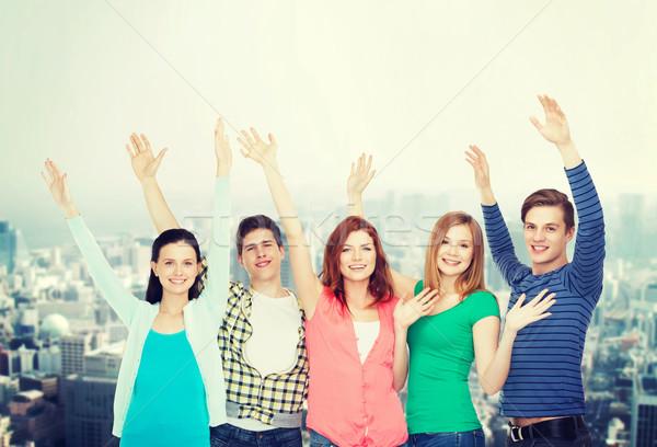 Grup gülen Öğrenciler eller eğitim Stok fotoğraf © dolgachov