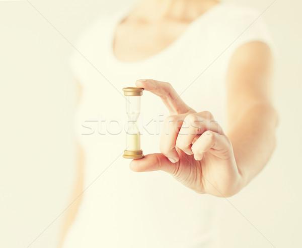 Kadın kum saati el eller Stok fotoğraf © dolgachov