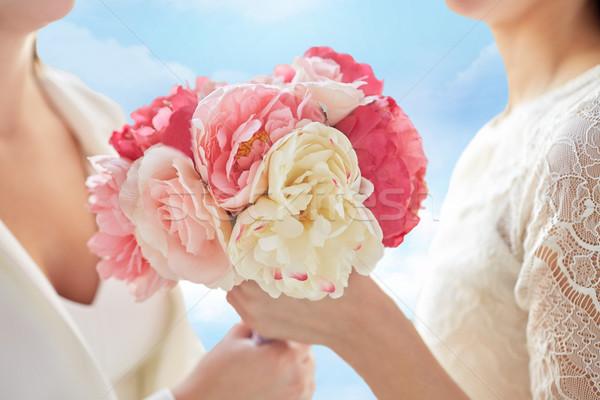 Feliz lesbianas Pareja flores personas Foto stock © dolgachov