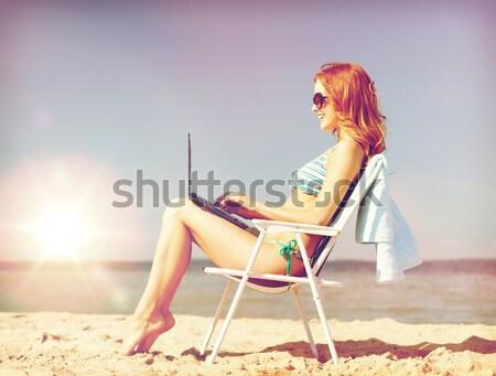 笑みを浮かべて 若い女性 日光浴 ラウンジ ビーチ 夏休み ストックフォト © dolgachov
