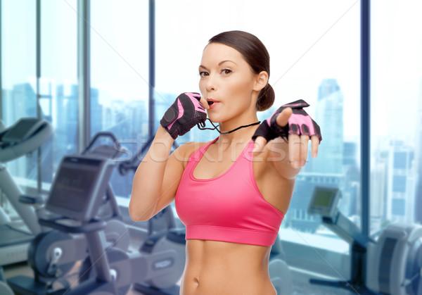 Asya kadın koç ıslık spor salonu Stok fotoğraf © dolgachov