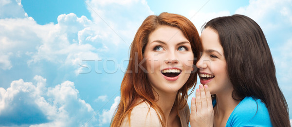 Stock photo: teenage girls or women whispering gossip