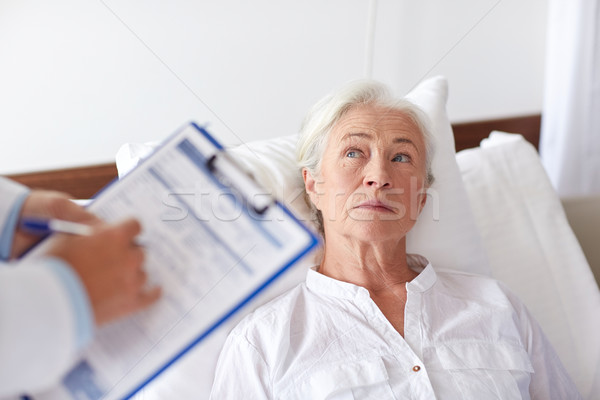 doctor visiting senior woman patient at hospital Stock photo © dolgachov