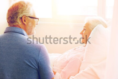 unhappy couple having argument at bedroom Stock photo © dolgachov