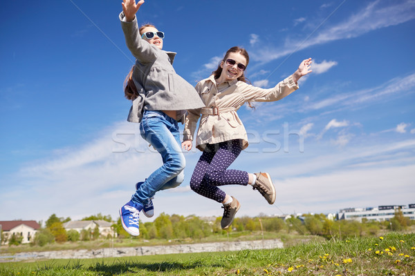 happy little girls jumping high outdoors Stock photo © dolgachov