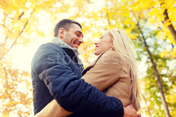 smiling couple hugging in autumn park Stock photo © dolgachov